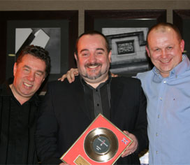 Receiving an another award from directors of Unit One Entertainment, Steve Sale & Jonny Spangles